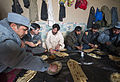 Afghan Uniform Police (AUP) members have a lunch meeting with the Afghan Local Police (ALP) commander for the Shah Joy district of Zabul province, Afghanistan, Feb 120207-N-CI175-176.jpg