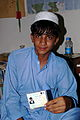 Afghan voter shows his voter card.jpg