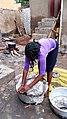 African woman preparing to cook.jpg