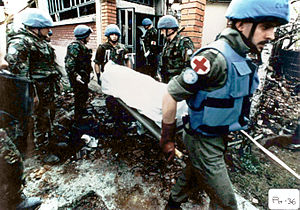 Croat–Bosniak War - UN peacekeepers collecting corpses after the massacre in Ahmići.