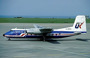 AirUK - An Air UK Handley Page Dart Herald in the modified blue-and-white scheme at Jersey Airport in 1983.