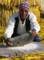 Amerindian man using a stone mortar and pestle.png