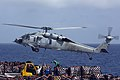An MH-60S Sea Hawk helicopter picks up supplies. (8722867783).jpg