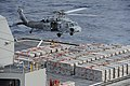 An MH-60S picks up ammo at sea. (8390303518).jpg