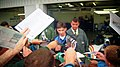 An autograph scrum for Damon Hill at the 1995 British GP, Silverstone (49713882897).jpg
