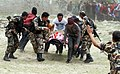 An injured person on a stretcher, carried by the Nepalese Army from a quake-hit area in Nepal for medical treatment.jpg
