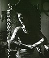 Andre Logan sitting in an Anthony Redmile shell chair.photo; ©Barry P Beckett1971.jpg