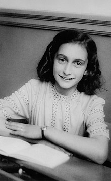Anne Frank smiling for her school photograph in 1941.