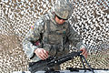 Army Spc. Adam Bardwell disassembles an M249 light machine gun during the Noncommissioned Officer and Soldier of the Year competition at Fort Carson, Colo., May 8, 2012 120508-A-YY130-027.jpg