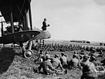 Army chaplain conducts a service from the cockpit of an aeroplane, France, during World War I (3017163160).jpg