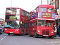 Arriva London buses VLA157 (LJ55 BSU) & RM54 (LDS 279A), Whitehall, route 159, 9 December 2005.jpg