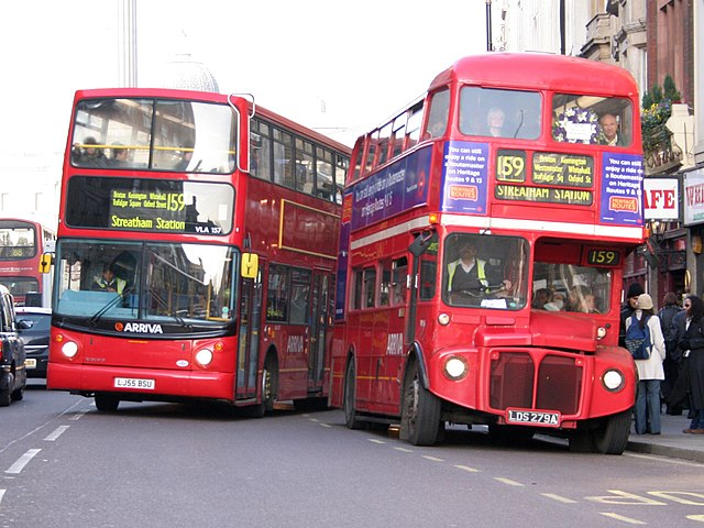 Arriva London buses VLA157 (LJ55 BSU) & RM54 (LDS 279A), Whitehall, route 159, 9 December 2005