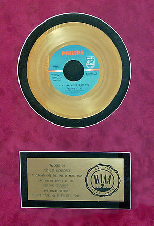 "Artie Schroeck - Gold record (for the sale of one million copies) presented to Artie Schroeck for his arrangement on ""Can't Take My Eyes Off You"", 1967"