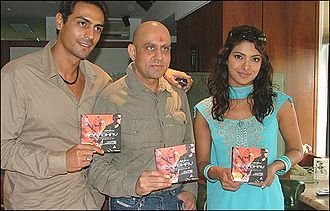 Rajiv Rai - Rajiv Rai (center) with Arjun Rampal and Priyanka Chopra during the music launch of Asambhav (2004).