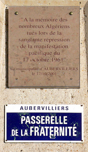 Canal Saint-Denis - Memorial plaque commemorating the October 17, 1961 massacre of Algerians committed under the orders of Maurice Papon, chief of the Paris police.  The plaque is located under a bridge in Aubervilliers.