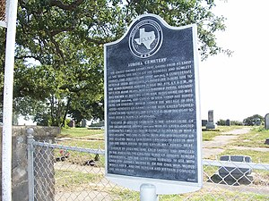 Aurora, Texas, UFO incident - A Texas Historical Commission marker outside the Aurora Cemetery, alleged burial site of the UFO pilot, which briefly mentions the incident.