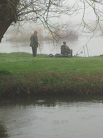 River Avon, Hampshire - An angling scene at the Hampshire Avon at the Royalty fishery, Christchurch, Dorset in March 2017.
