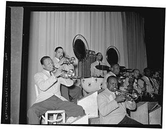 Otto Hardwick - From right: Barney Bigard, Ben Webster, Otto Hardwick, Harry Carney, Rex Stewart, Sonny Greer, Wallace Jones (?), Ray Nance.  Photography by William P. Gottlieb.