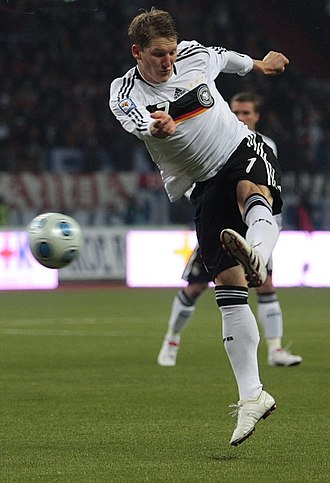 Bastian Schweinsteiger - Schweinsteiger taking a shot for Germany in 2009