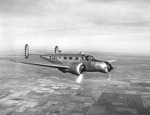 Beechcraft Model 18 - Instructor and pilot in an AT-7 doing navigation training at Kelly Field, Texas.