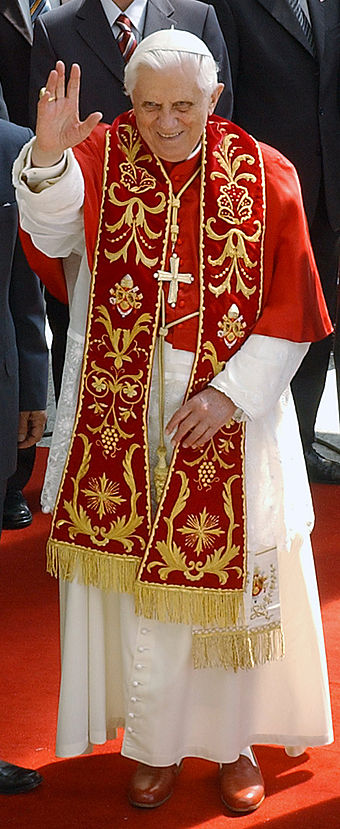 Pope Benedict XVI in choir dress with the red summer papal mozzetta, embroidered red stole, and the red papal shoes BentoXVI-29-10052007.jpg