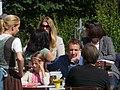 Bergdoktor Filmset in Going - am Tisch sitzend Heiko Ruprecht (Hans Gruber).jpg