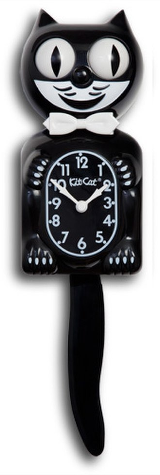 Kit-Cat Klock - Above, an original model clock with packaging from the 1940s. Below, a black newer model clock displays four paws.