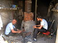 Blacksmith and his son in the Bazaar of Nishapur 3.JPG