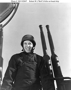 USS Alabama (BB-60) - Bob Feller by a 40 mm quadruple anti-aircraft gun mount, probably on board USS Alabama in 1943.