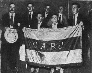 1925 Boca Juniors tour to Europe - Pozzo, Vaccaro and Medice holding a Boca Juniors flag, a gift from Jockey Club of Buenos Aires.