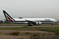 Boeing 777-243ER I-DISE Alitalia (6655519605).jpg