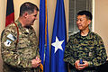 Brig. Gen. Thomas Deale, 455th Air Expeditionary Wing commander, speaks with Col. Wankyu Choi, Republic of Korea Provincial Reconstruction Force commander, at Bagram Airfield, Afghanistan.JPG