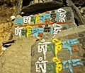 Buddhist mantras carved and painted on stones on the trail to Khumbu Nepal - panoramio.jpg