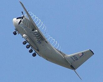 Contrail - C-27J Spartan with propeller tip vortex condensation