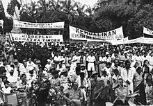 Large crowd, holding banners