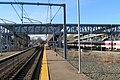 Canton Junction footbridge and inbound Stoughton train, April 2016.JPG