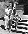 Caption- Wayne Sutter, of Peoria, Illinois, served in Summer Voluntary Service at Frontier Boys Camp as a special education consultant to the camp. Here he is counseling one of the boys with whom he (14136470771).jpg