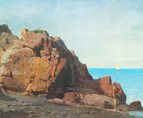 An angler on a rocky shore.