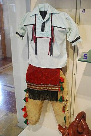 Mexican Kickapoo - Kikapú boy's ceremonial dress on display at the Centro de Desarrollo Artesanal Indígena in Santiago de Queretaro.