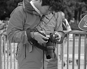 Chimping - A tourist chimping on his Canon EOS 60D camera in Athens, Greece in October 2013