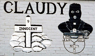 Claudy bombing - A 2004 loyalist mural on Lower Newtownards Road in Belfast making reference to the bombing. It shows a priest wearing a balaclava and holding a bomb and rosary beads.
