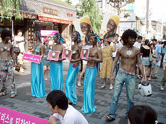 History of Raëlism - Clitoraid event in South Korea with Koreans in blackface.
