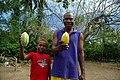Cocoa farmer David Kebu Jnr and his son Snider Kebu display cocoa pods from Kebu farm. (10687079704).jpg