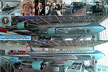 "A metal-trussed hanger with a glass front and a shiny floor holds a large jet emblazoned with ""United States of American"" and other artifacts."
