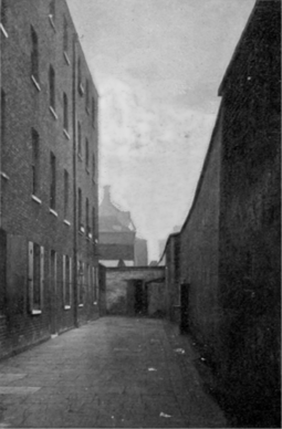 The Marshalsea around 1897, after it had closed. Dickens based several of his characters on the experience of seeing his father in the debtors' prison, most notably Amy Dorrit from Little Dorrit. Courtyard of the former Marshalsea prison, 1897 (2).png