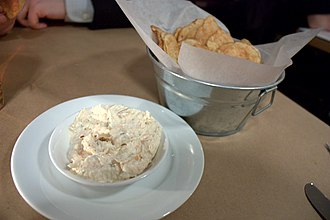 In the United States, March 23 is National Chips and Dip Day Crab dip and old bay chips.jpg