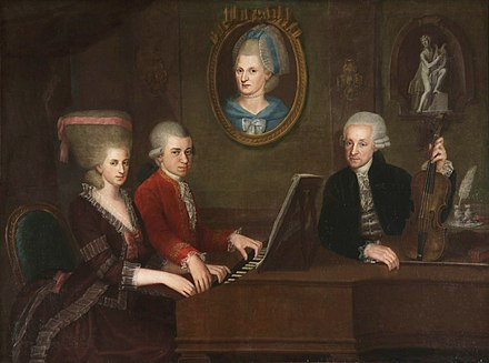 Mozart family c. 1780 (della Croce); the portrait on the wall is of Mozart's mother. Croce MozartFamilyPortrait.jpg