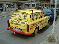 Yellow station wagon with advertising