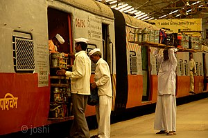 Dabbawala - Dabbawala loading lunch boxes on a train
