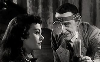 The Daughter of Dr. Jekyll - Gloria Talbott and Arthur Shields in the film